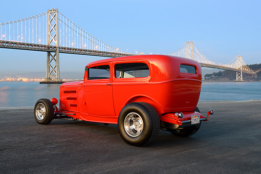 AUT 26 RK3449 01 © Kimball Stock 1932 Ford Tudor Hot Rod Red 3/4 Side View On Pavement By Bay Bridge At Dusk