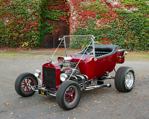 AUT 26 RK3453 01 © Kimball Stock 1923 Ford T-Bucket Maroon 3/4 Front View On Gravel By Ivy Covered Wall