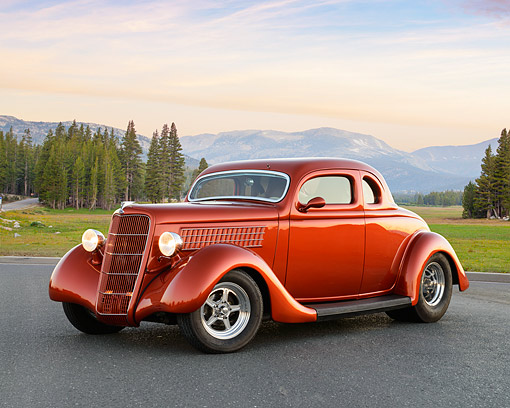 AUT 26 RK3457 01 © Kimball Stock 1935 Ford 5 Window Coupe Orange 3/4 Front View On Pavement By Mountains At Dusk