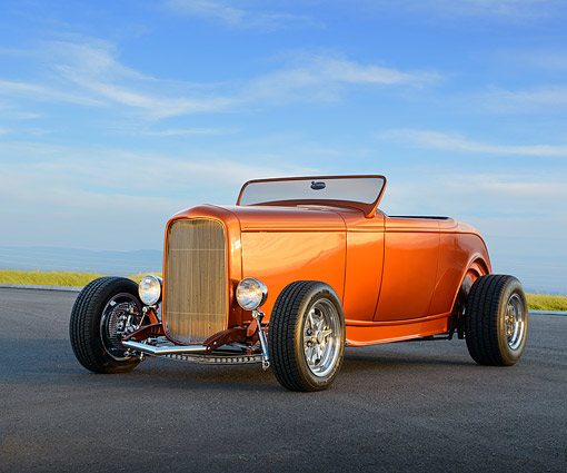 AUT 26 RK3459 01 © Kimball Stock 1932 Ford Roadster Sunburst Orange 3/4 Front View On Pavement