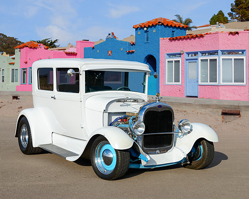 AUT 26 RK3461 01 © Kimball Stock 1928 Ford Model A White 3/4 Front View On Pavement By Colorful Buildings