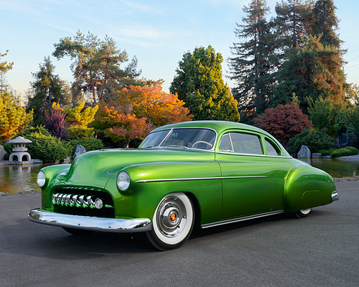 AUT 26 RK3462 01 © Kimball Stock 1949 Chevrolet Sport Coupe Green 3/4 Front View On Pavement By Pond And Autumn Trees