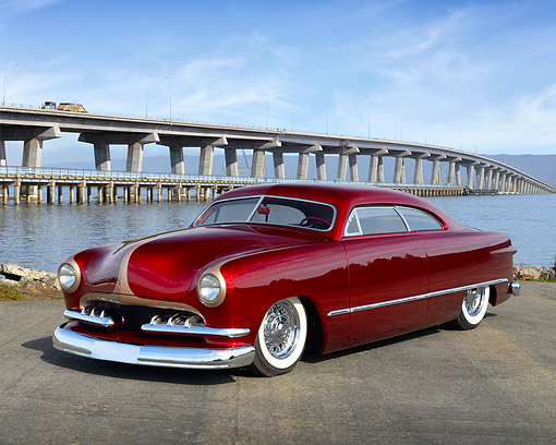 AUT 26 RK3464 01 © Kimball Stock 1949 Ford Coupe Apple Red 3/4 Front View On Pavement By Bridge