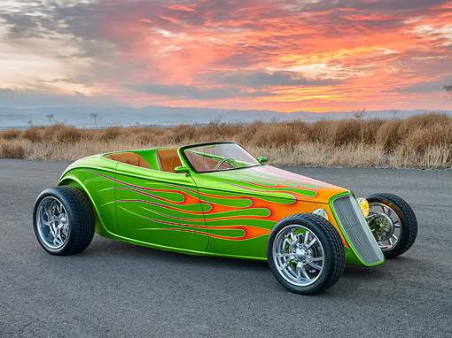 AUT 26 RK3473 01 © Kimball Stock 1933 Ford Alloway Roadster Green With Flames 3/4 Side View On Pavement By Field At Dusk