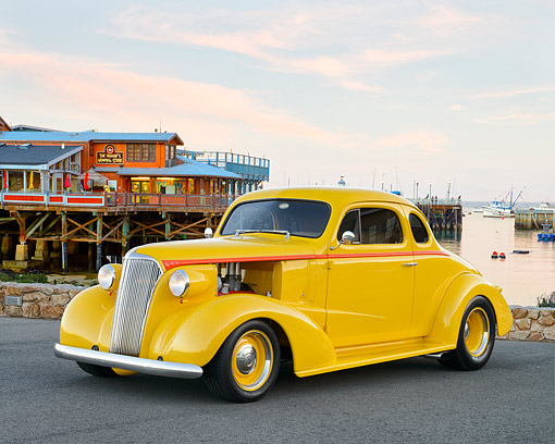 AUT 26 RK3476 01 © Kimball Stock 1937 Chevy Coupe Yellow 3/4 Front View On Pavement