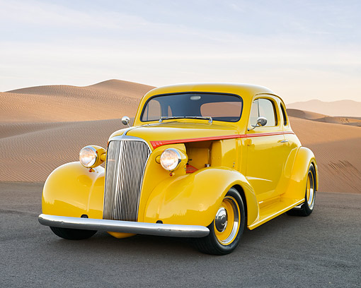 AUT 26 RK3479 01 © Kimball Stock 1937 Chevy Coupe Yellow 3/4 Fron View In Desert