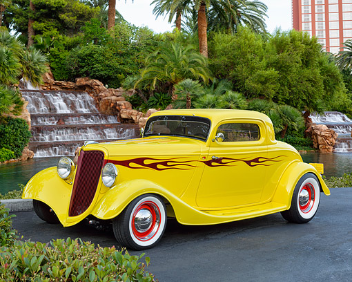 AUT 26 RK3482 01 © Kimball Stock 1934 Ford Coupe Yellow With Flames 3/4 Front View By Fancy Vegas Hotel