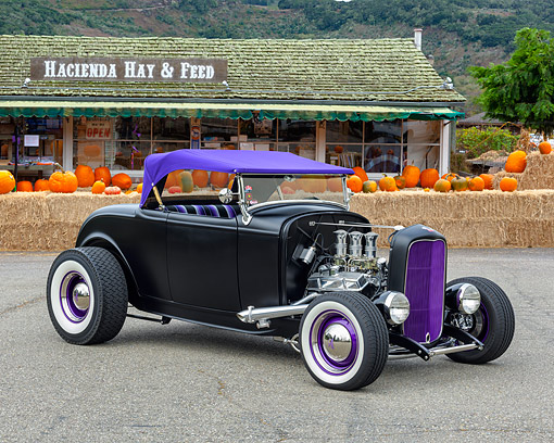 AUT 26 RK3487 01 © Kimball Stock 1932 Ford Roadster Satin Black And Purple 3/4 Front View By Hay And Pumpkins