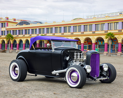 AUT 26 RK3488 01 © Kimball Stock 1932 Ford Roadster Satin Black And Purple 3/4 Front View On Beach Boardwalk