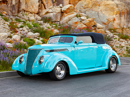 AUT 26 RK3489 01 © Kimball Stock 1937 Ford Coupe Hot Rod Turquoise 3/4 Front View On Road By Rocks And Flowers