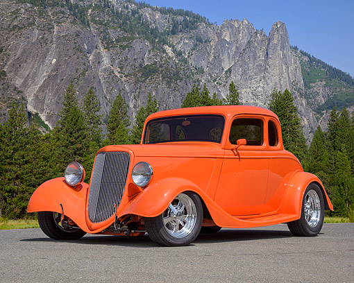 AUT 26 RK3503 01 © Kimball Stock 1934 Ford 5 Window Coupe Hot Rod Orange 3/4 Front View On Road By Mountain