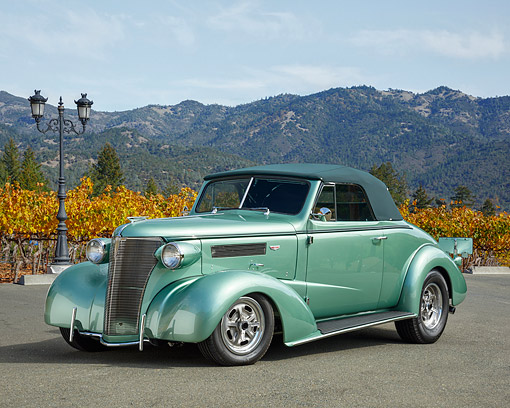 AUT 26 RK3507 01 © Kimball Stock 1938 Chevrolet Anniversary 427 Hot Rod Convertible Green 3/4 Front View By Vineyard And Mountains