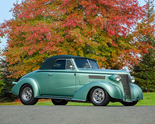 AUT 26 RK3509 01 © Kimball Stock 1938 Chevrolet Anniversary 427 Hot Rod Convertible Green 3/4 Front View By Autumn Tree