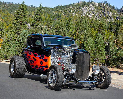 AUT 26 RK3518 01 © Kimball Stock 1932 Ford Five Window Coupe Hot Rod Black With Flames 3/4 Front View By Trees