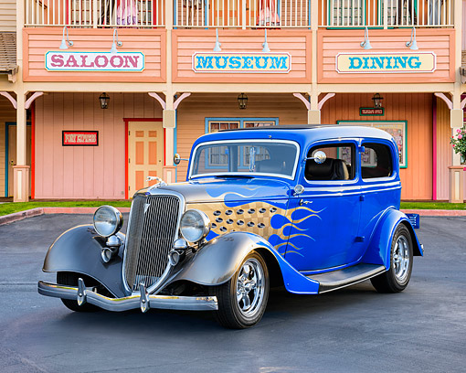 AUT 26 RK3520 01 © Kimball Stock 1934 Ford 2-Door Sedan Blue With Gold Flames 3/4 Front View By Building