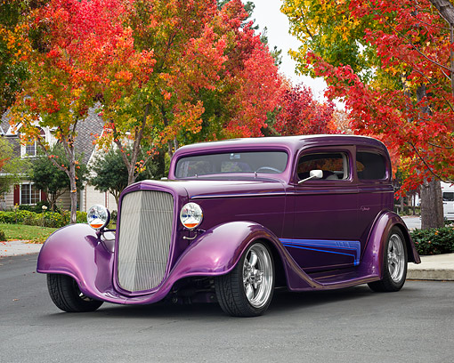 AUT 26 RK3526 01 © Kimball Stock 1935 Chevrolet Sedan Hot Rod Plum 3/4 Front View By Autumn Trees