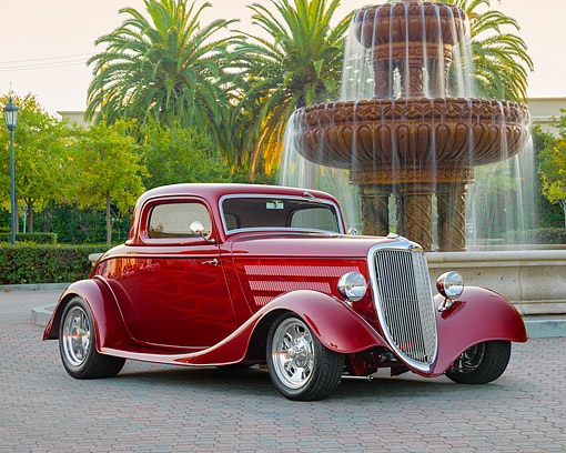 AUT 26 RK3528 01 © Kimball Stock 1934 Ford Model 40B Coupe Hot Rod Maroon With Flames 3/4 Front View By Fountain