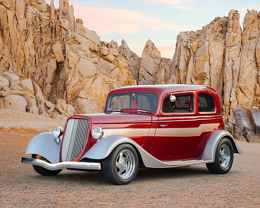 AUT 26 RK3541 01 © Kimball Stock 1933 Ford Tudor Hot Rod Red With Graphics 3/4 Front View In Desert