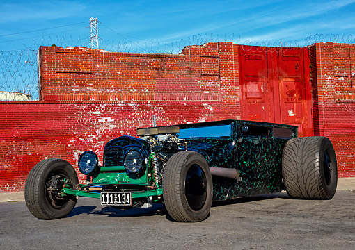 AUT 26 RK3543 01 © Kimball Stock 1923 Hot Rod Extreme Black With Green 3/4 Front View On Pavement By Bricks
