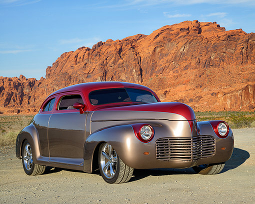AUT 26 RK3546 01 © Kimball Stock 1943 Chevrolet Coupe Hot Rod Red And Gold 3/4 Front View In Desert