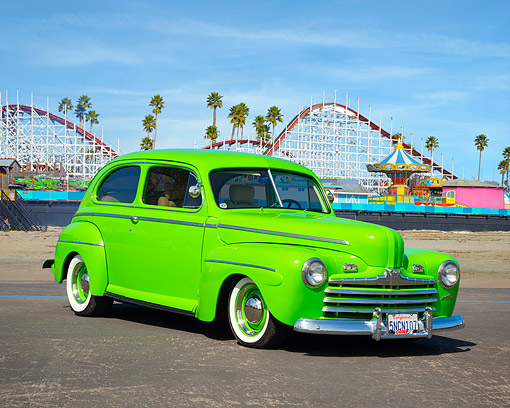 AUT 26 RK3550 01 © Kimball Stock 1946 Ford Tudor Sedan Super Deluxe Hot Rod Green 3/4 Front View By Amusement Park