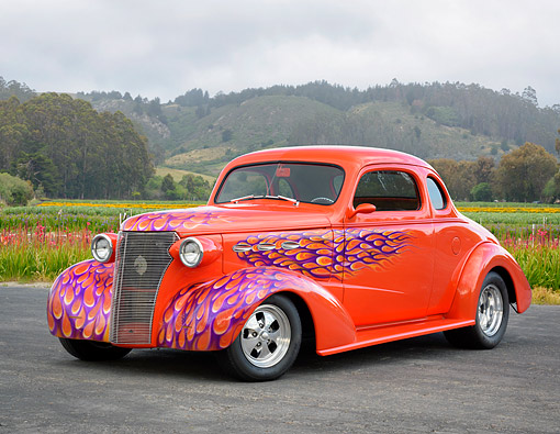 AUT 26 RK3570 01 © Kimball Stock 1938 Chevrolet 5-Window Business Coupe Orange With Flames 3/4 Front View By Hills