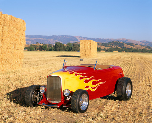 AUT 26 RK0039 04 © Kimball Stock 1932 Ford Hi-Boy Roadster Red And Yellow 3/4 Front View By Hay Bales