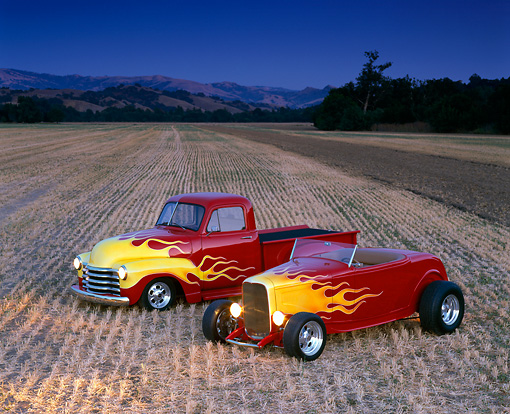 AUT 26 RK0047 01 © Kimball Stock 1932 Ford Roadster & 1952 Chevrolet Pickup Red Yellow Flames 3/4 Front View in Farm Field