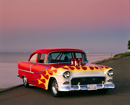 AUT 26 RK0080 01 © Kimball Stock 1955 Chevrolet Bel Air Pro Street Rod Red With Flames Front 3/4 Front View By Water