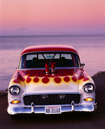 AUT 26 RK0083 06 © Kimball Stock 1955 Chevrolet Bel Air Pro Street Rod With Flames Head On By Water At Dusk