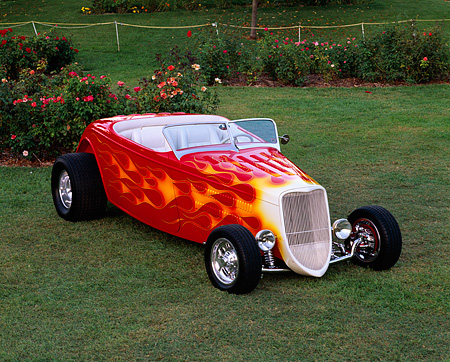 AUT 26 RK0089 05 © Kimball Stock 1933 Ford Hi Boy Convertible Red With Flames Front 3/4 View On Grass