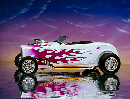 AUT 26 RK0104 09 © Kimball Stock 1932 Ford Hi Boy Roadster White Purple Flames 3/4 Front View On Mylar Floor Studio