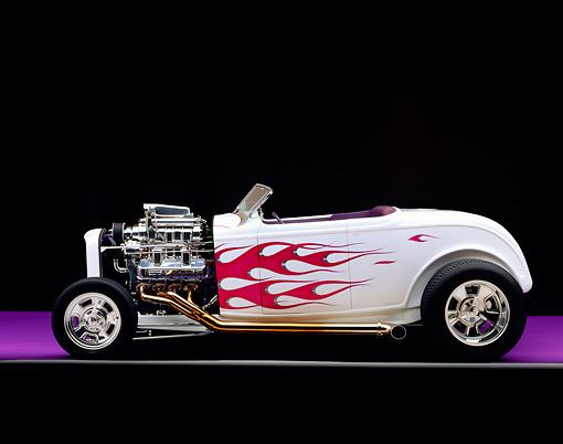 AUT 26 RK0108 05 © Kimball Stock 1932 Ford Hi Boy Roadster White Purple Flames Profile View On Purple Floor Gray Line Engine Exposed Studio