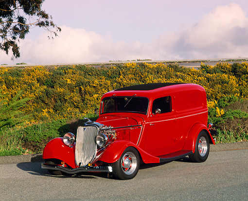 AUT 26 RK0177 02 © Kimball Stock 1933 Ford Sedan Delivery Red 3/4 Front View On Pavement  By Shrubs Filtered