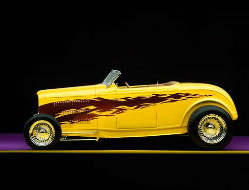AUT 26 RK0180 05 © Kimball Stock 1932 Ford Hi Boy Convertible Yellow Purple Flames Profile View Studio