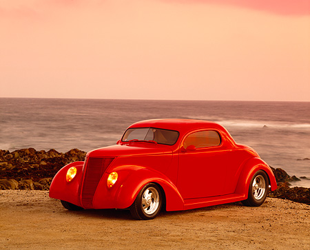 AUT 26 RK0186 03 © Kimball Stock 1937 Ford 3 Window Coupe 350 Red 3/4 Side View on Sand By Ocean Filtered