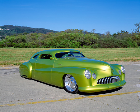 AUT 26 RK0230 04 © Kimball Stock 1948 Buick Roadmaster Custom Green 3/4 Front View On Pavement By Grass And Bushes