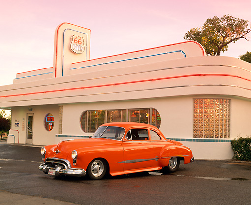 AUT 26 RK0242 03 © Kimball Stock 1949 Oldsmobile Coupe ProStreet Orange Front 3/4 View On Pavement By Diner