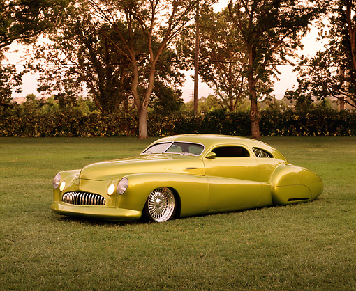 AUT 26 RK0245 02 © Kimball Stock 1948 Buick Roadmaster Custom Green 3/4 Front View On Grass By Trees