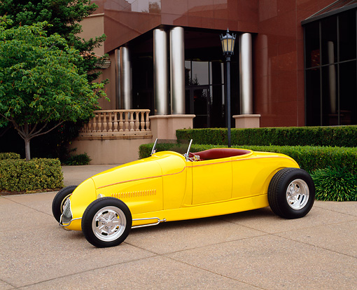 AUT 26 RK0255 03 © Kimball Stock 1929 Ford Hi-Boy Hot Rod Yellow 3/4 Front View By Building