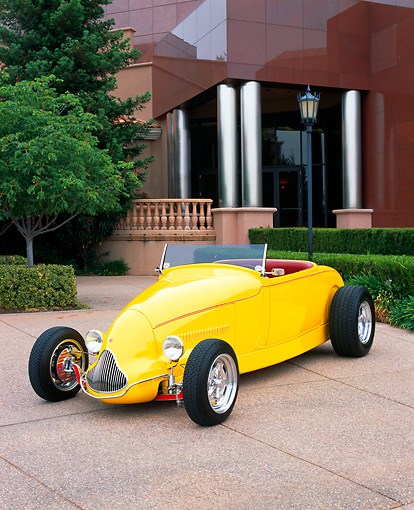 AUT 26 RK0256 02 © Kimball Stock 1929 Ford Highboy Yellow 3/4 Front View On Pavement By Trees And Bushes