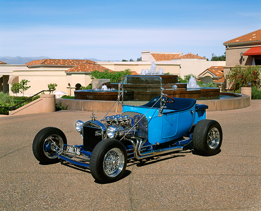 AUT 26 RK0268 01 © Kimball Stock 1923 Ford T Bucket Custom Blue 3/4 Side View On Pavement By Water Fountain