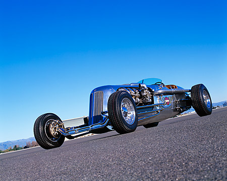 AUT 26 RK0282 01 © Kimball Stock Blastolene Special Concept Race Car Low Slanted 3/4 Front View On Pavement Blue Sky