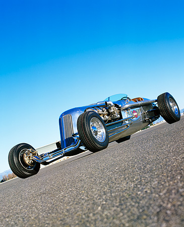 AUT 26 RK0282 03 © Kimball Stock Blastolene Special Concept Race Car Low Slanted 3/4 Front View On Pavement Blue Sky