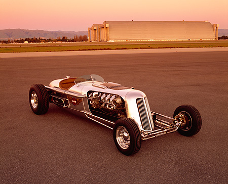 AUT 26 RK0289 02 © Kimball Stock Blastolene Special Concept Race Car 3/4 Front View On Pavement Airplane Hanger Filtered