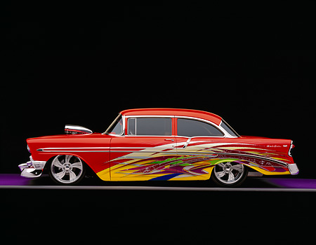 AUT 26 RK0292 04 © Kimball Stock 1956 Custom Chevy Bel Air Orange With Graphics Profile On Purple Floor Gray Line Studio