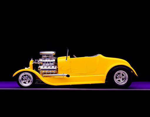 AUT 26 RK0346 05 © Kimball Stock 1927 Ford Roadster Yellow Side View On Purple Floor Gray Line Studio