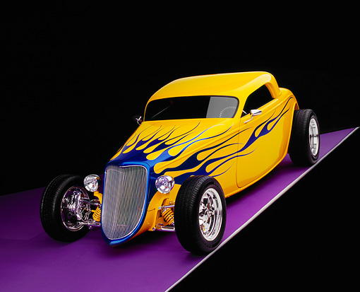 AUT 26 RK0385 04 © Kimball Stock 2004 Speed Star Coupe Yellow Blue Flames 3/4 Front View On Purple Floor Gray Line Studio