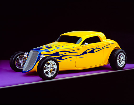 AUT 26 RK0387 08 © Kimball Stock 2004 Speed Star Coupe Yellow Blue Flames 3/4 Side View On Purple Floor Gray Line Studio
