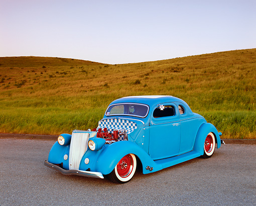 AUT 26 RK0391 05 © Kimball Stock 1936 Ford Custom Coupe Light Blue 3/4 Front View On Pavement By Grass Hill
